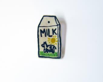 handmade and painted 'milk' badge!