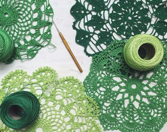 A set of 4 greens handcrocheted doilies