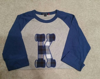Large K in plaid baseball t