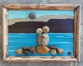 """Pebble Art Family of Three (Parents & Child/Baby) by the Lake/Ocean (NOW ON SALE-was 75.00) set in an """"open"""" 5x7 wood frame (Free Shipping)"""