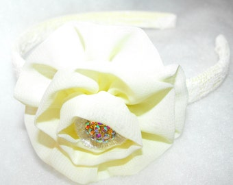 """Headband Ivory Ribbon Flower on a 1/2"""" Lace Wrapped Ivory Headband with an Iridescent Sparkle Embellishment"""
