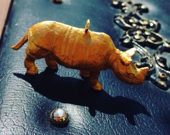 Golden rhinoceros pendant