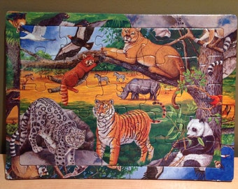 Vintage 1996 Endangered Species Puzzle by K & M International Inc.  Beautiful colorful graphics with this 25 piece cardboard puzzle. By lift