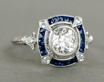 Antique Cushion Cut Diamond and Sapphire Halo Platinum Engagement Ring