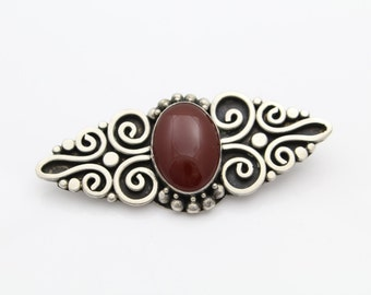 Antique Finish Sterling Silver and Carnelian Brooch. [6415]