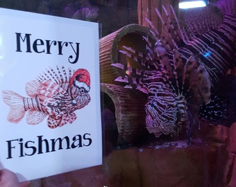 Merry Fishmas fine art Christmas card. Pen and ink lionfish wearing a Santa hat by Candy Medusa. Fish pun, animal puns, funny marine biology