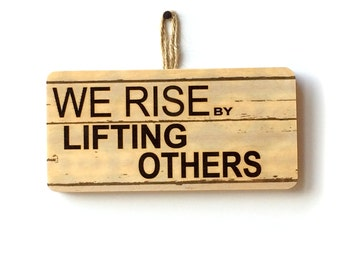 We Rise By Lifting Others Wooden Sign
