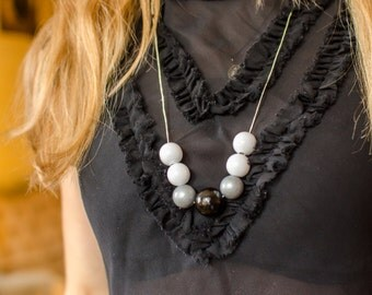 White, black and silver necklace