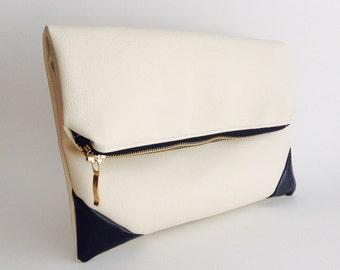 Fold over zipper clutch bag