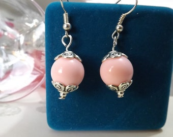 Pale Pink earrings with swirl caps