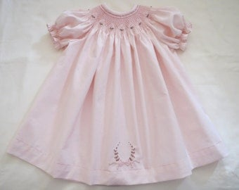 Lovely Light Pale Pink Hand Smocked Round Yoke Bishop Dress for Baby Girl.