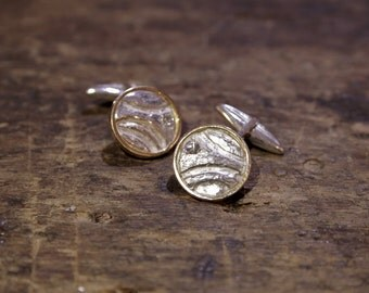 Silver and gold cufflinks with diamonds
