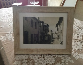 A framed print in sepa 'Typically France '