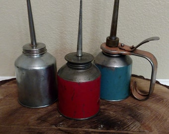 Set of 3 Mid-century metal oil cans with distressed finish.