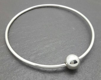 Sterling silver 2mm thick bangle with a sterling silver floating bead