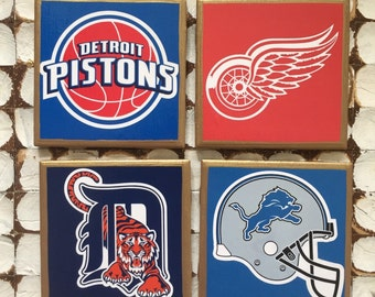 COASTERS! I heart Detroit sports! Pistons, Red Wings, Tigers and Lions coasters with gold trim