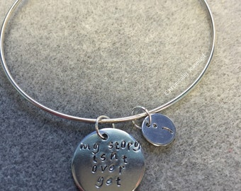 My story isnt over yet- hand stamped bracelet