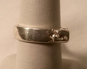 Asymmetrical Ring with Carved Corner