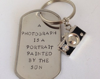 Hand stamped Keychain: A Photo is a Portrait Painted by the Sun Keychain