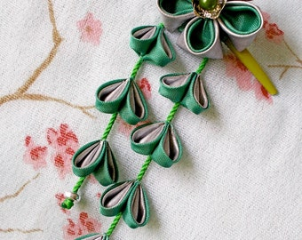 Fork with Japanese flower fabric with petals hanging kanzashi shidare in green and silver.