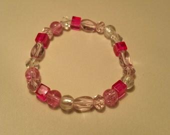 Pink beaded bracelet.