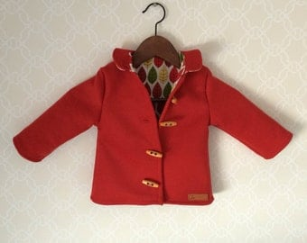 Wool monty-coat in red with peter pan collar.