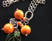 Long Chain Necklace, orange beads, leaf jewellery, flower charm, pendant on a silver chain, Jewellery for Her, Spring Trends, March Finds