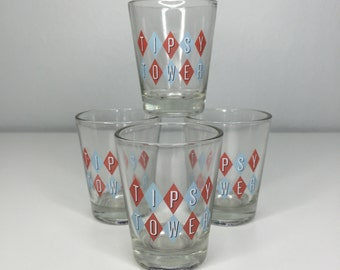 set of FOUR vintage Tipsy Tower shot glasses