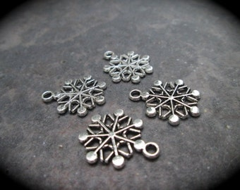 Snowflake charms Package of 4 antique silver highly detailed charms double sided Christmas Charms