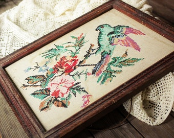Art nouveau vintage cross-stich with parrot and flowers. Made in 1900s