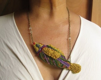 golden fish necklace