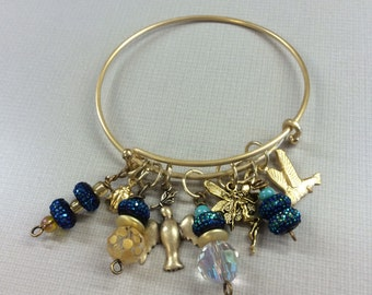 Wire bracelet with assorted beads and charms