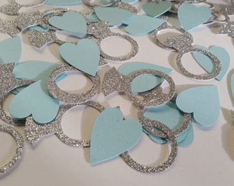 Tiffany blue/ turquoise card hearts and silver glitter ring table confetti. Engagement, wedding, hen party, bridal party table decoration.
