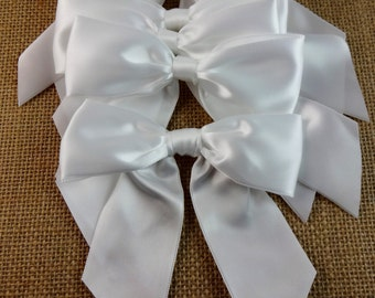 White satin bows, 4.5 inches wide, set of six.  Craft supply for wedding decorations, floral arrangements and DIY projects.