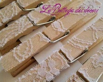 8 wooden pegs, hand decorated with lace