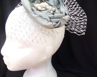 Silver satin hand crafted flower hair accessory, Silver netting.