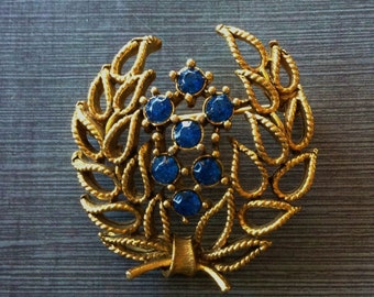 Vintage Lisner Gold Tone Laurel Wreath Brooch with Sapphire Blue Rhinestones