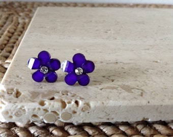 Fun and flirty Royal Purple acrylic flower Stud Earrings. Small but pack a punch of shimmer with a hint of glitter and a faux diamond.