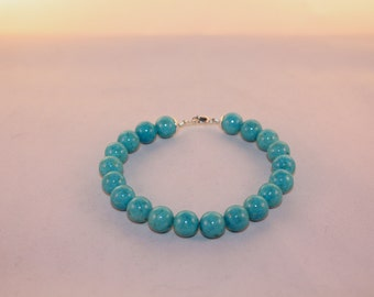 Turquoise riverstone and sterling silver bead bracelet