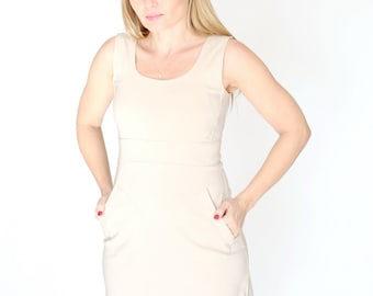 Casual beige dress with A line minimal sleeveless classic dress with zipper back.