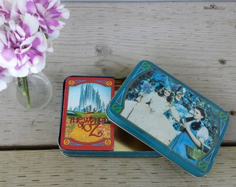 blue tin with wizard of oz card deck, the good witch and dorothy