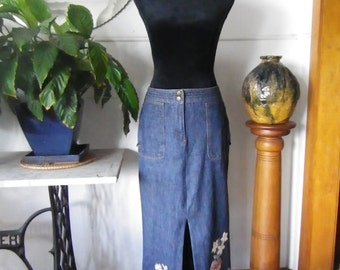 Denim maxi skirt with front slit and floral embellishment