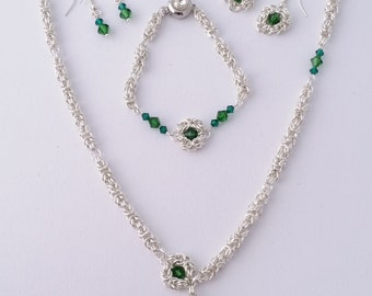 Green Swarovski crystal byzantine pattern chain maille jewelry set, with a necklace, a bracelet, and two pair of earrings.