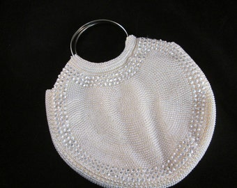 A Vintage Round White Beaded 1970's Disco Era Purse from Hong Kong.