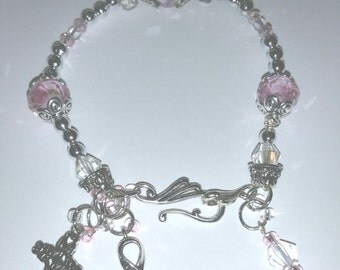 Delicate Silver and Pink Crystal charm bracelet of faith.