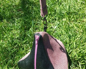 Pink and black triangle purse with matching wristlet strap.