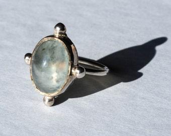 Silver ring and prehnite
