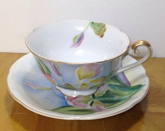 Vintage ginger Hawaiin teacup saucer hand painted pink blue green yellow  and trimmed in gold