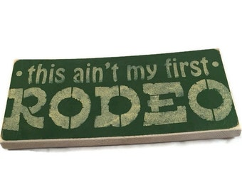 This Ain't My First Rodeo - Rustic Wooden Sign - Cowboy Rodeo Sign - Funny Gift For Him - Custom Wood Signs - Birthday Party Gift