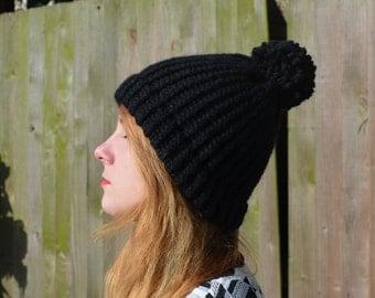 Black Hat with wool pom pom